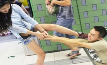 LOL! Mobile Madness: Girl Drags Boyfriend Off Train For Texting