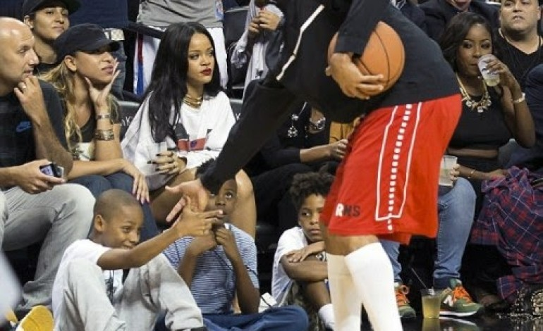 Photos: Rihanna & Chris Brown cross paths at charity game in NYC