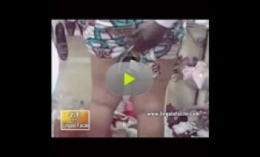 This is bad! A lady caught stealing a bottle of wine from a shop in Abidjan disgraced