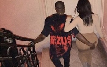 Photos: Kanye West grabs his wife's massive butt