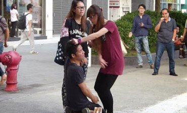 Photos: Furious Girlfriend Makes Cheating Boyfriend Kneel In The Street While She Slaps, Humiliates Him