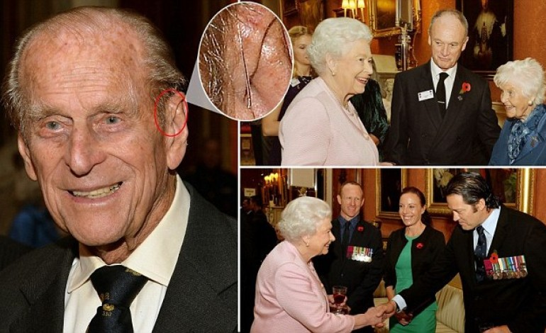 Prince Philip is seen with a hearing aid for the first time as he and the Queen meet hero Victoria Cross veterans in London