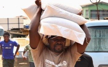 WOW! SEE T.B. Joshua carrying Three Bags of Rice on His Head