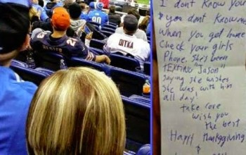 Football fan passes note to man after spotting his girlfriend sending romantic texts to another man during a match