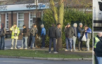 Dawn in suburbia: Up to 200 migrants join queue for work... outside a north-west London bar called the Honeypot