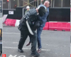 Pics: Incredible moment man in suit takes on thief with a machete on London street