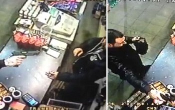 Incredible moment fearless shopkeeper snatches gun out of raider's hand before chasing him out of the store
