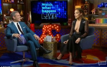 Photos: JLo displays cleavage in plunging dress during interview