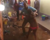 Photos: Neighbours stand and watch as man beats his wife almost to death for cheating