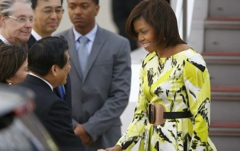 Michelle Obama stuns in floral Kenzo dress as she arrirves Japan