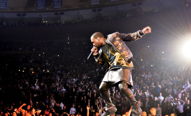 #OMG! #KanyeWest Jumps Into A Lake While Performing [PHOTOS]