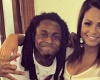 Lil Wayne done with Christina Milian? Hints there's an opening in the harem