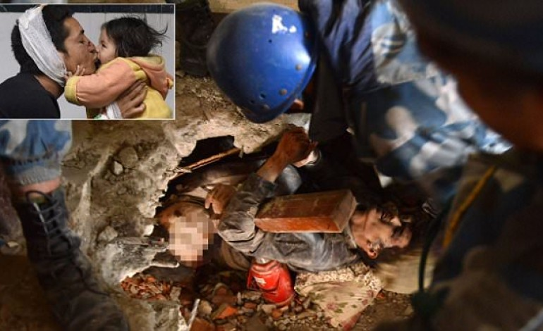 The tiny gap between life and death: #Entombed alive with the body of his friend, #Nepal #earthquake victim is finally pulled free as death toll rises to 2,500