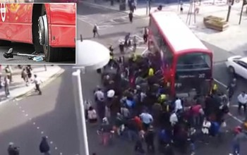 Amazing moment up to 100 people lift double decker bus off trapped unicyclist