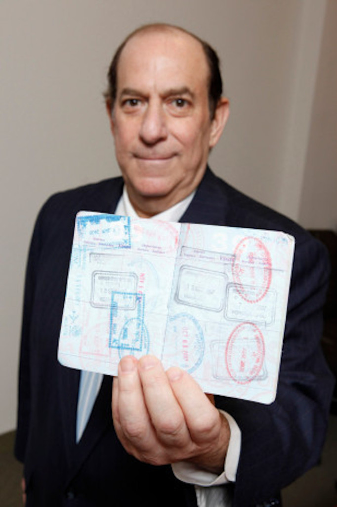 NEW YORK - FOR SUNDAY NEWS:  The man who flew too much, Steve Rothstein, 61, in his midtown Manhattan office, Manhattan, NY, on Wednesday, May 9, 2012.     PICTURED: Steve Rothstein holds his passport.   (Photo by Angel Chevrestt, 646.314.3206)