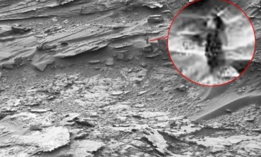 Dark Lady on Mars: NASA's Rover spots mysterious being looking out into space from red planet