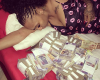 See Actress Princess Pemu Sleeping on Bundles of Money