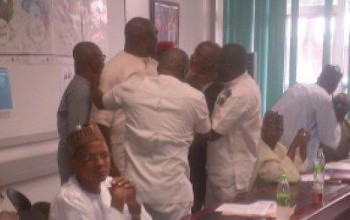 Photos: NFF President Amaju Pinnick & Chris Giwa almost get physical during 'peace' meeting with Sports Minister in Abuja