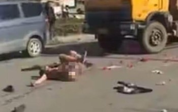 Pics: Man rolls around on the road naked after girlfriend rejects his marriage proposal