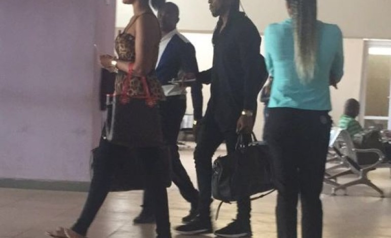 Flavour and babymama Sandra spotted at Enugu airport (photo)