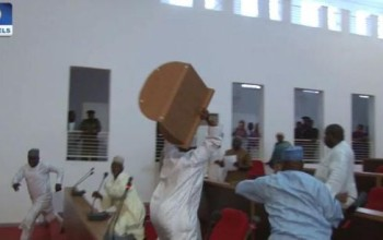 Photo/Video: Nassarawa state lawmakers fight dirty in their chambers over appointment of sole administrators