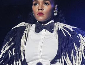 Singer Janelle Monáe reveals her cousin was killed by a spray of bullets while sleeping at home