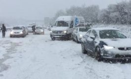 UK weather: Travel warnings after night of snowfall
