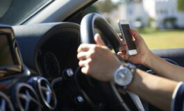 Drivers to be banned from picking up mobile phones